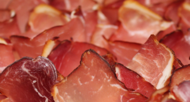 The Difference Between Commercial and Artisan Ham